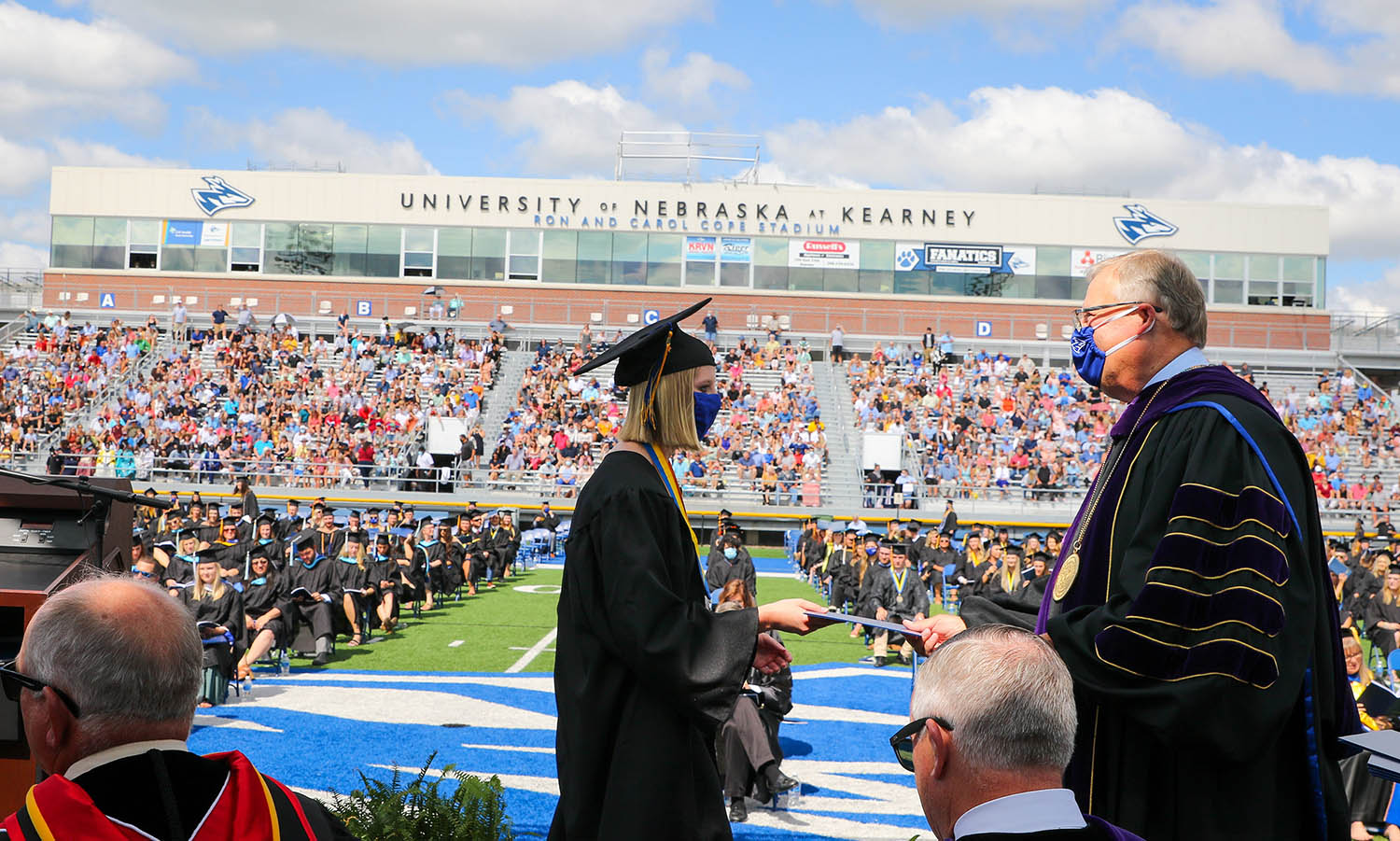 UNK graduate Haley Pierce of West Point has her degree conferred by Chancellor Doug Kristensen during Friday's commencement ceremony at Cope Stadium.