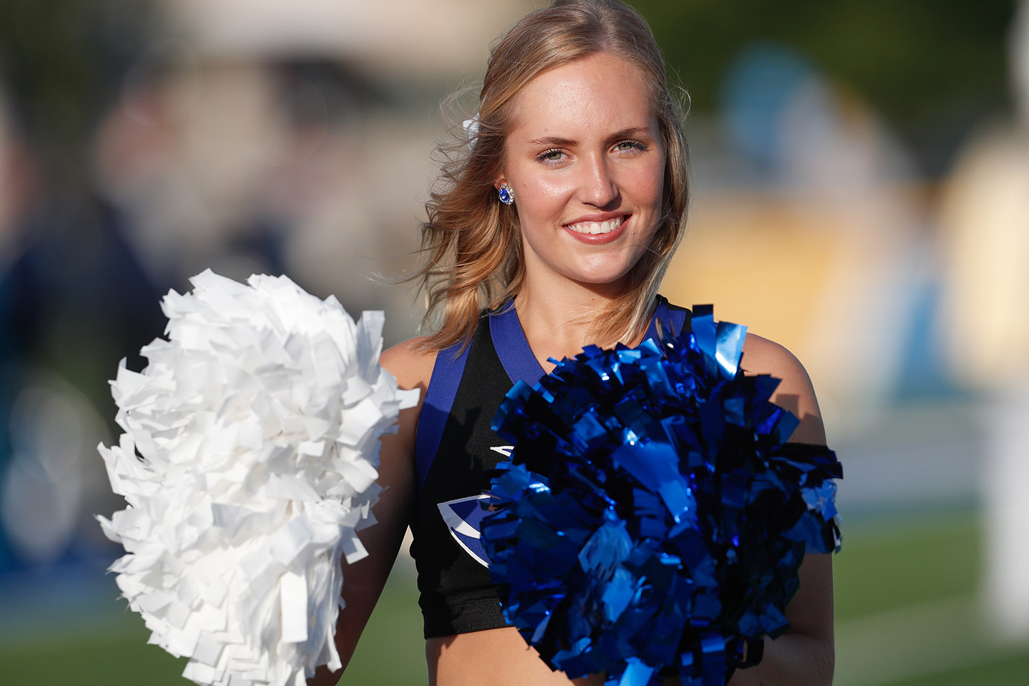 UNK cheerleader Emily Petersen hopes to put on a different uniform when she graduates from college. The Omaha native is training to be an officer in the U.S. Marine Corps.