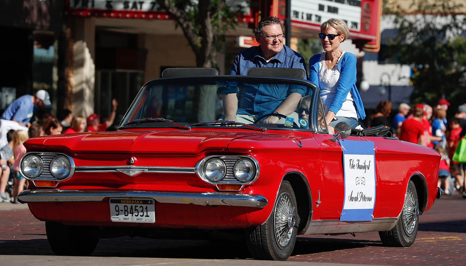 David and Patti Petersen are pictured during the 2018 homecoming parade, when they were recognized along with their four daughters as the UNK Outstanding Family.