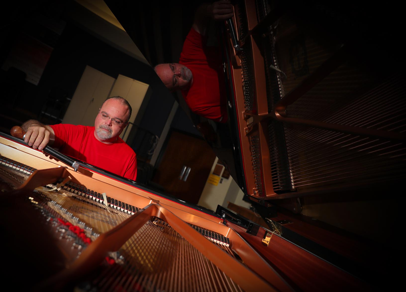 UNK piano technician Mick Johnson tunes a piano inside the Fine Arts Building. Johnson cares for approximately 55 pianos on campus, plus one at the Museum of Nebraska Art in downtown Kearney. (Photos by Corbey R. Dorsey, UNK Communications)