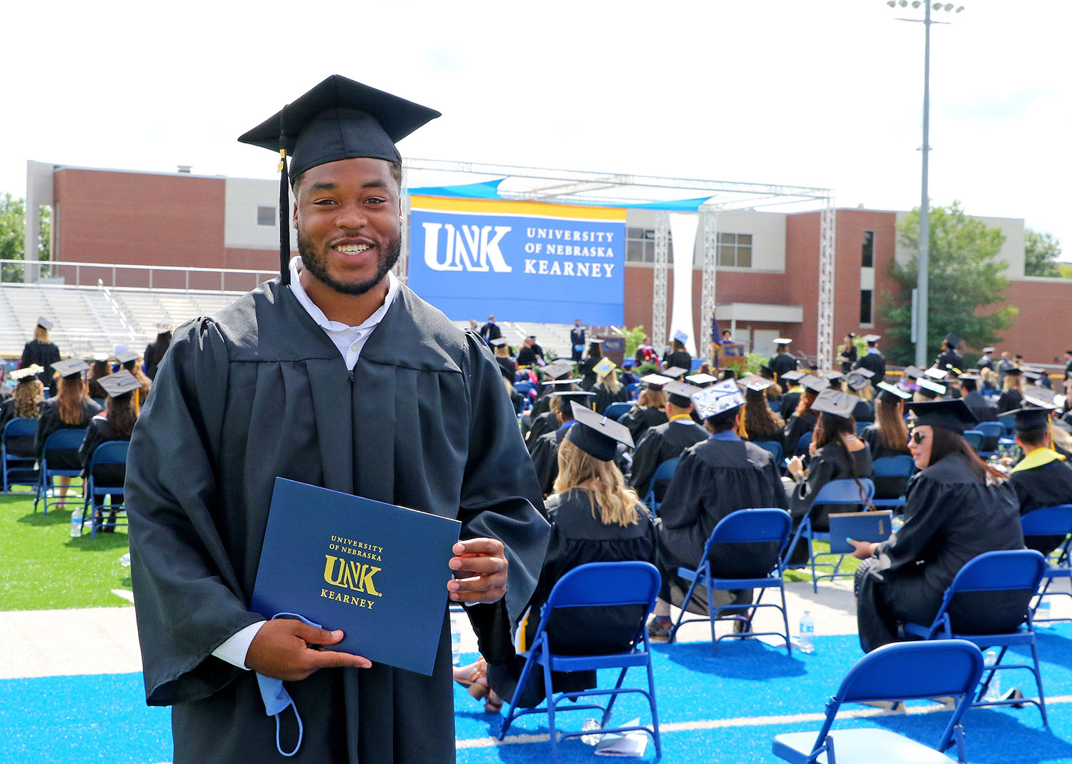 "Rakid Hill's family traveled from St. Louis, Missouri, to watch him receive his degree during Friday's commencement ceremony at UNK. ""My mom and dad wanted to see me walk,"" Hill said. ""I'm their first kid to graduate from a university, so that was big for them."" (Photos by Todd Gottula, UNK Communications)"