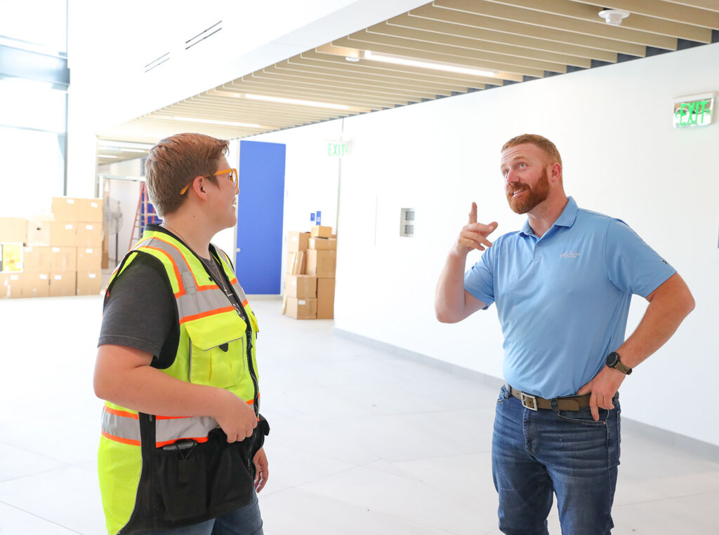 UNK senior Velerianna Garcia and Hausmann Construction project superintendent Marc Fredericks are pictured inside Discovery Hall.