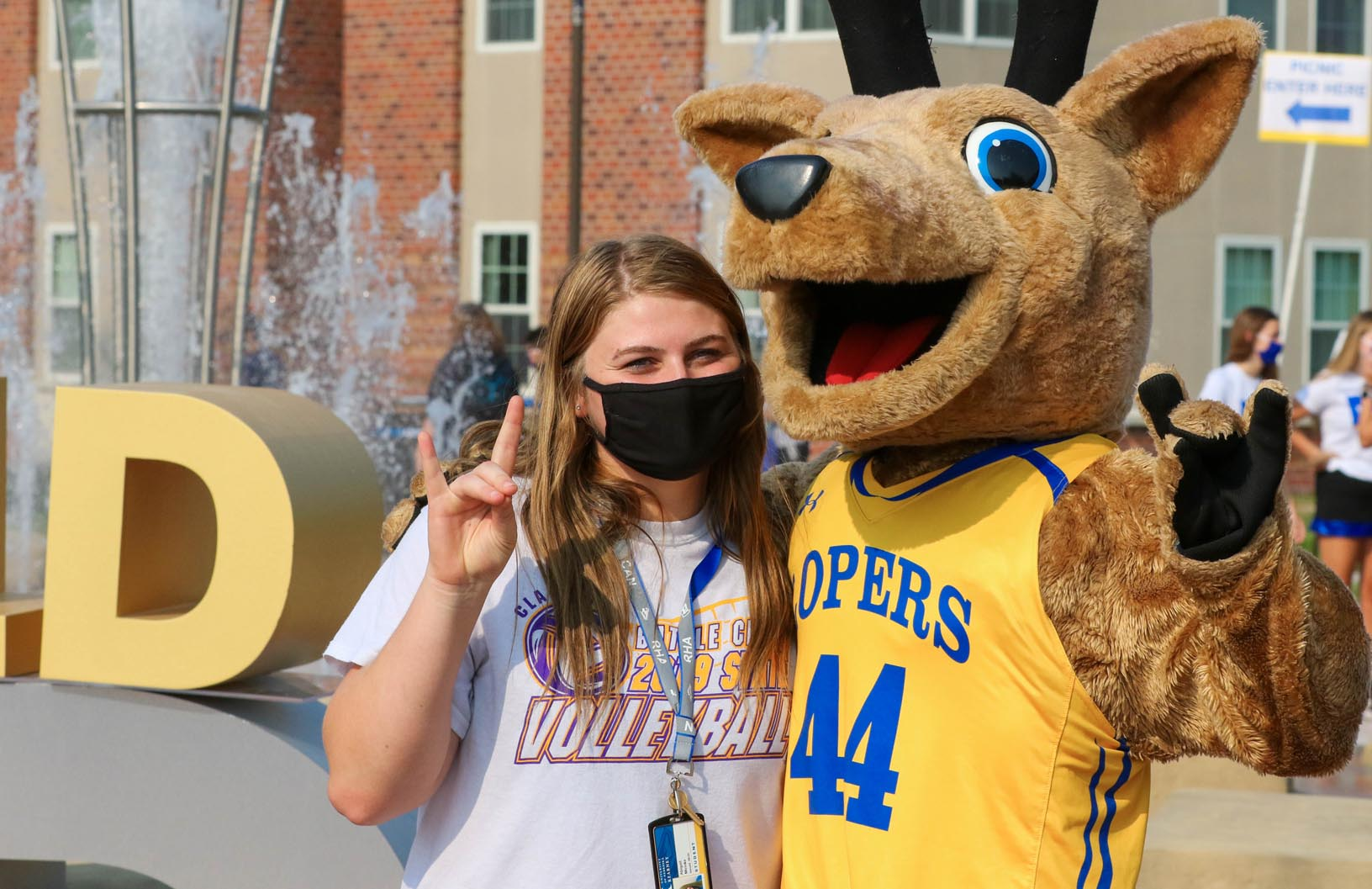 UNK student Abigail Meinke poses for a photo with Louie the Loper during Friday's Blue and Gold Showcase on campus.