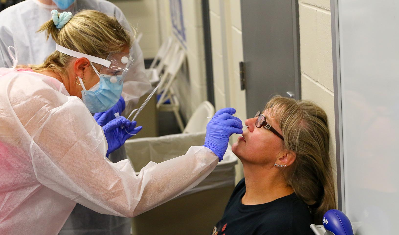 UNK biology professor Kim Carlson, right, is tested for COVID-19 on Thursday during a trial run for a new campus testing program. Beginning next week, UNK will randomly test students, staff and faculty for the novel coronavirus, allowing university leadership and health officials to more closely monitor case numbers. (Photos by Todd Gottula, UNK Communications)