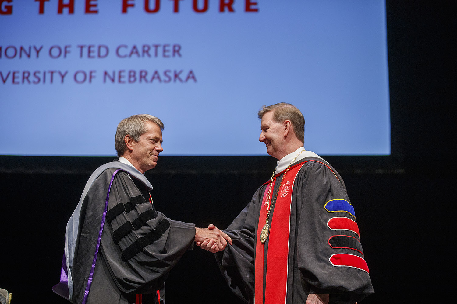 University of Nebraska President Ted Carter, right, receives congratulations from Board of Regents Chairman Jim Pillen during Friday's investiture ceremony. (Photos by Craig Chandler, UNL Communications)
