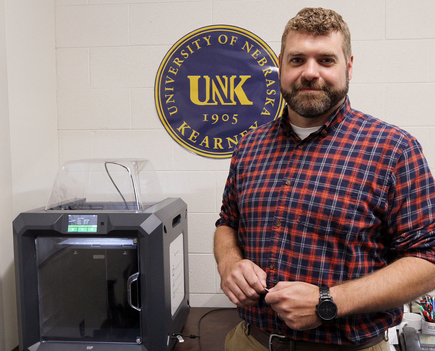 Michael Cremers, assistant director of UNK Facilities Management and Planning, uses a 3D printer to create a variety of parts instead of ordering them from an outside vendor. The 3D-printing program saves the department money and eliminates obstacles such as minimum order requirements and shipping delays. (Photos by Tyler Ellyson, UNK Communications)