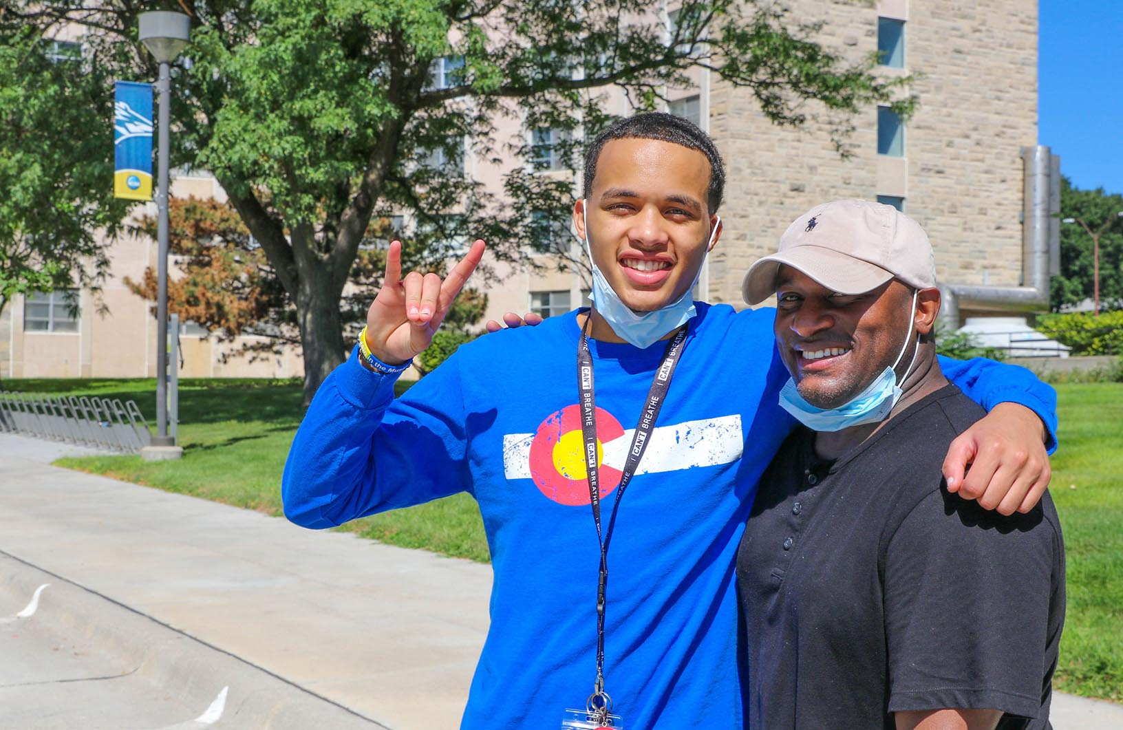 Freshman Matthew Robinson of Colorado Springs, Colorado, left, poses for a photo with his father Michael on the UNK campus. Robinson, who will study business administration, is attending UNK on a football scholarship.