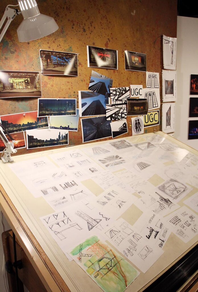 """Ahna Packard's sketches and set designs from the 2013 UNK musical """"Urinetown"""" are part of an exhibit on display at the Walker Art Gallery."""