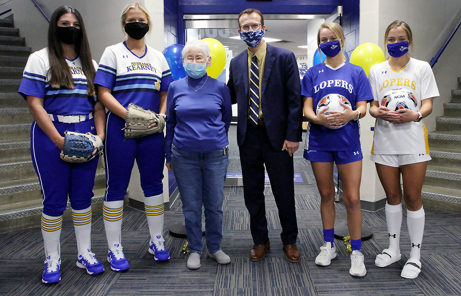 Donna Bamford, third from left, poses for a photo with UNK Athletic Director Marc Bauer and student-athletes from the Loper softball and soccer programs Tuesday during a dedication ceremony for the Donna Bamford Locker Room. Bamford provided funding to renovate a locker room for the softball and soccer teams. (Photos by Tyler Ellyson, UNK Communications)