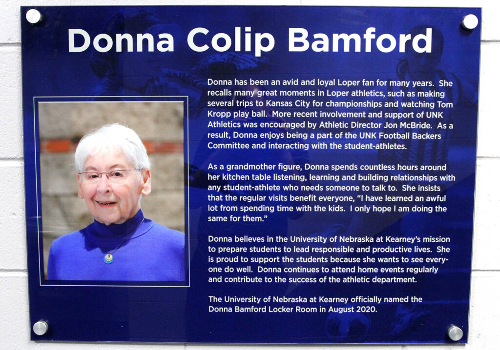 A plaque recognizing Donna Bamford's contributions to UNK is displayed outside a renovated locker room that will be used by the Loper softball and soccer teams.