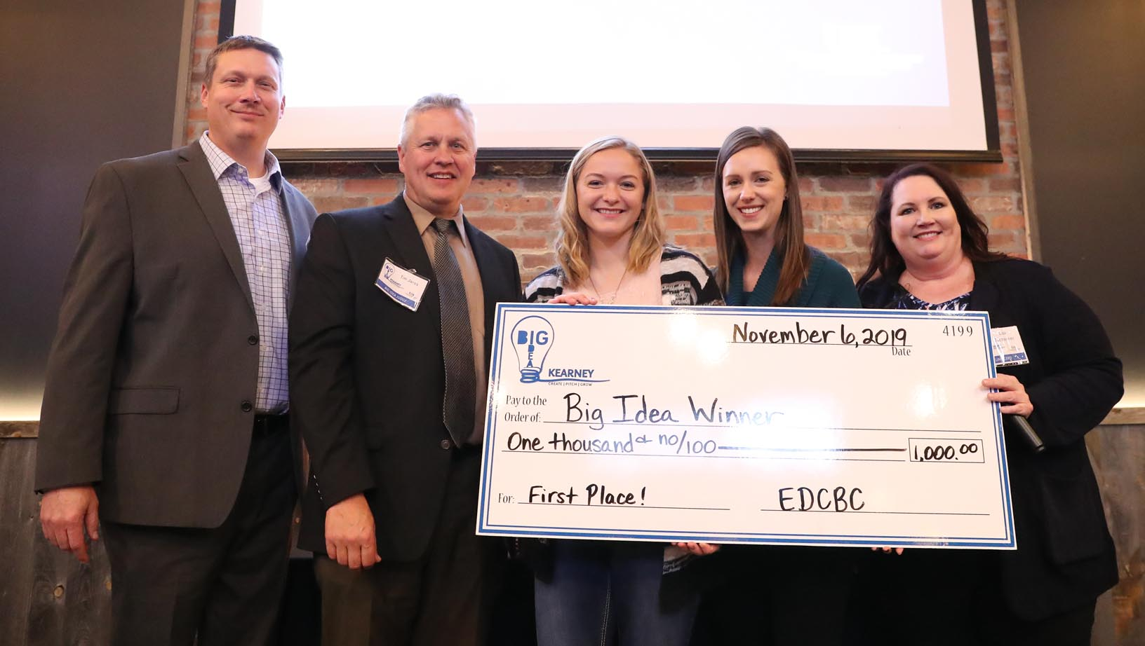 UNK student Nicole Mittman, center, pitched her glow-in-the-dark paintings to win the college division during last year's Big Idea Kearney competition. This year's business contest, Big Idea UNK, will be conducted completely online and it's open only to current UNK students.