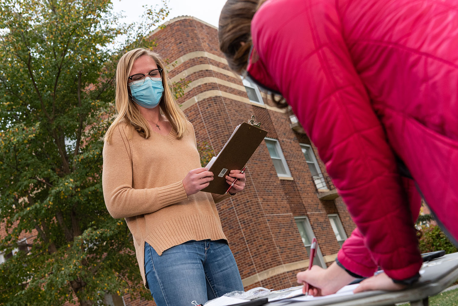 UNK junior Lydia Behnk of Elgin runs an informational table on campus where fellow students could register to vote or request an absentee ballot. (Photos by Kosuke Yoshii, UNK Communications)