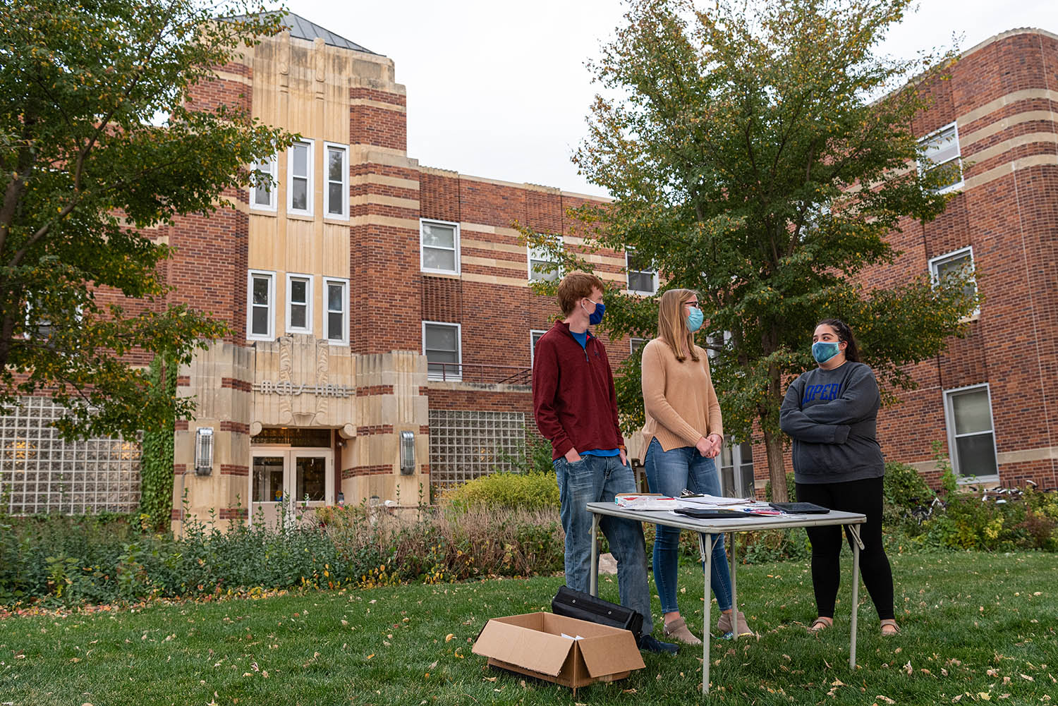 From left, sophomore Tanner Butler of Broken Bow, junior Lydia Behnk of Elgin and junior Rachel Phillips of Omaha volunteer at an early/absentee voting drive on the UNK campus.