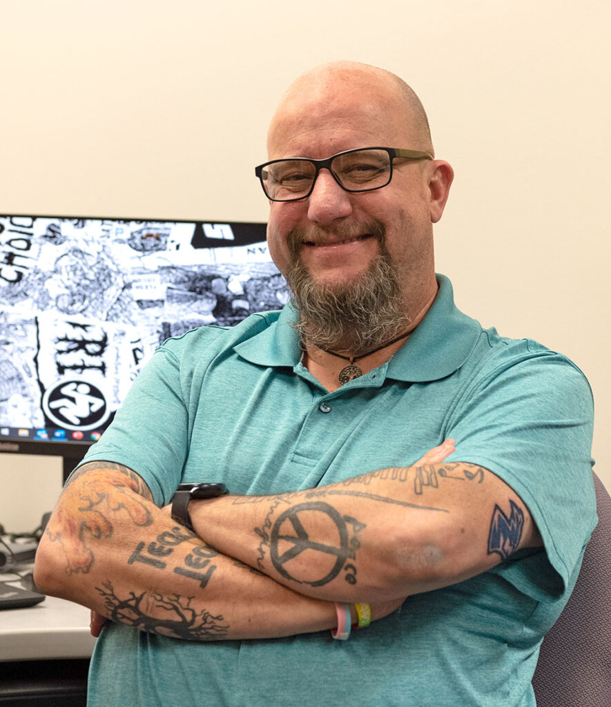 Drew Kemp has 37 tattoos, including images representing every university he's attended or worked at. He added a Loper head after joining UNK in August.