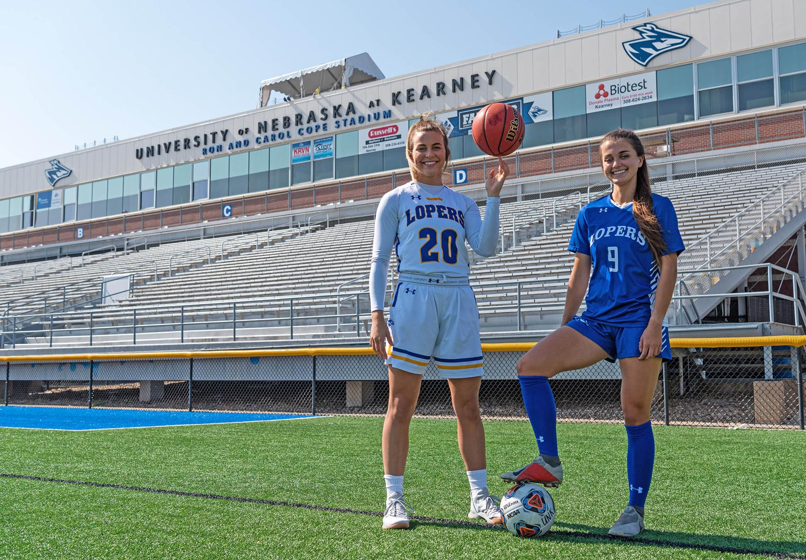 Klaire and Kassidy Kirsch are enjoying every moment of their time together at UNK. Klaire, a junior, is a starting guard on the UNK women's basketball team and Kassidy, a senior, is a forward and co-captain on the Loper soccer team. (Photo by Kosuke Yoshii, UNK Communications)