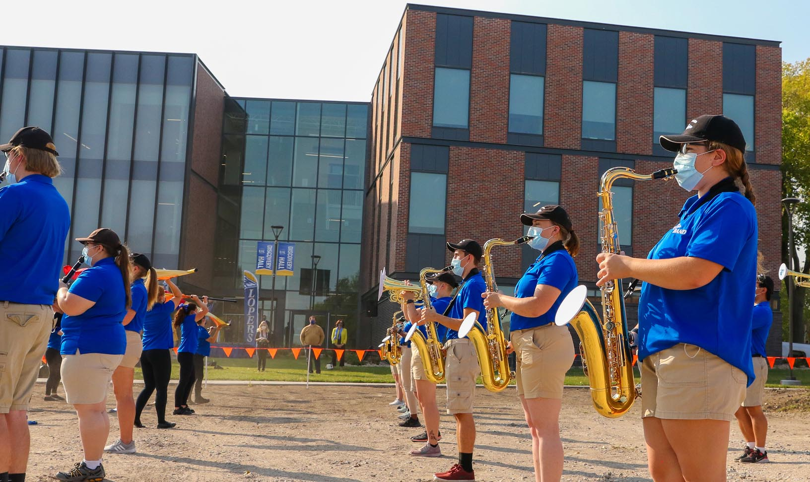UNK's Pride of the Plains Marching Band performs Monday during a ribbon-cutting ceremony celebrating the grand opening of Discovery Hall. The event kicked off homecoming week on campus.
