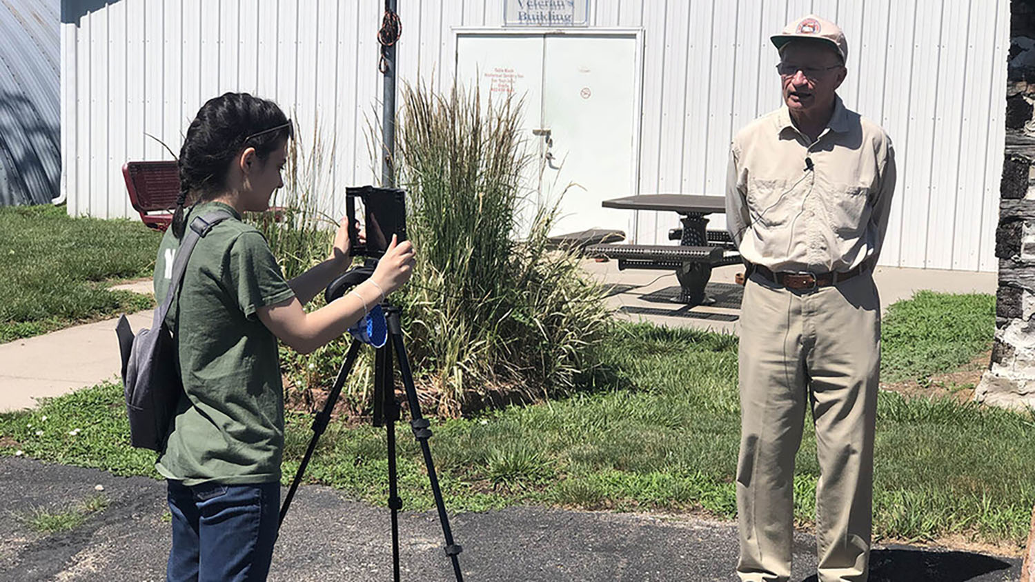 Rachel Williss, a junior agricultural and environmental sciences communication major at UNL, photographs Robert Diffendal, professor emeritus in the School of Natural Resources, during her fellowship this summer in Pawnee County.