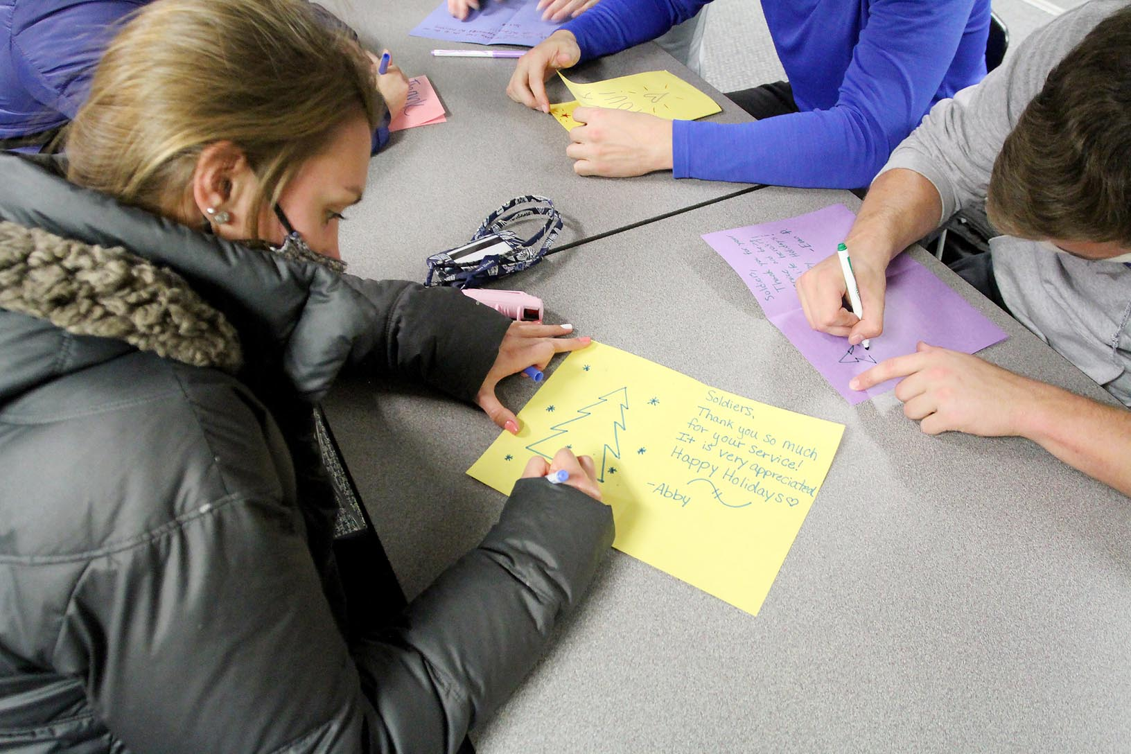 UNK student Abby Everitt of O'Neill creates a holiday card for a U.S. military member Tuesday evening during the Sisters for Soldiers event hosted by the Alpha Omicron Pi sorority.