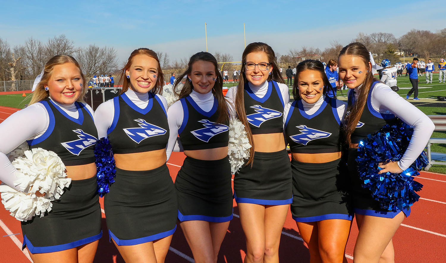 Krista Williams, third from right, and Fayth Jackson, second from right, were co-captains on the UNK cheer team before Williams graduated in May and became the head coach.
