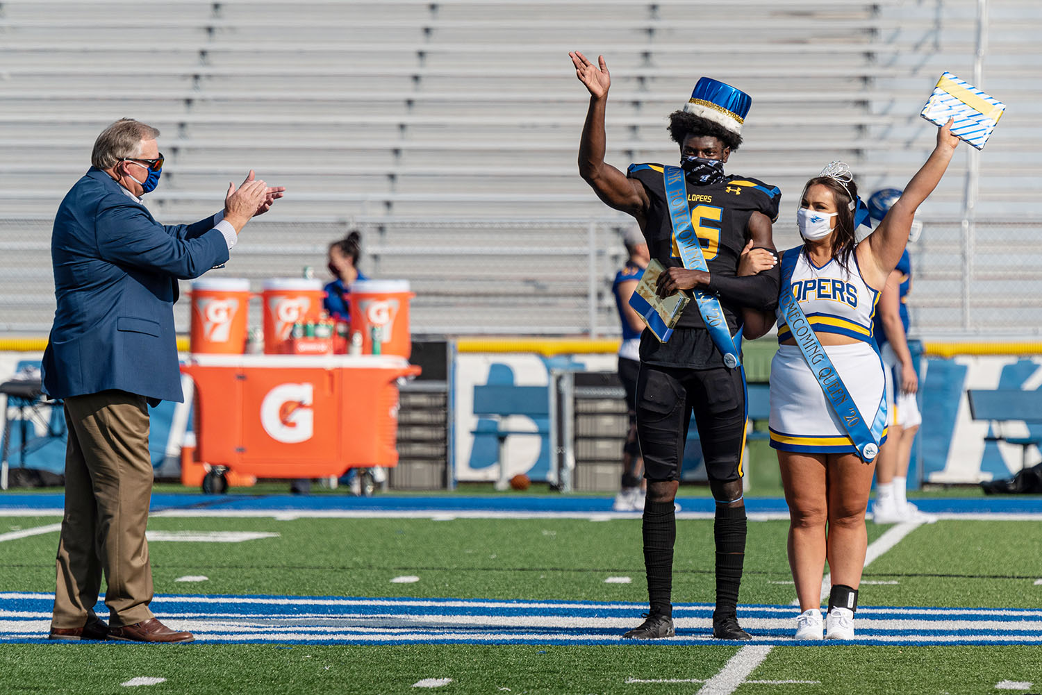 UNK homecoming king Gabriel Amegatcher and queen Fayth Jackson are recognized last month during halftime of the football scrimmage.