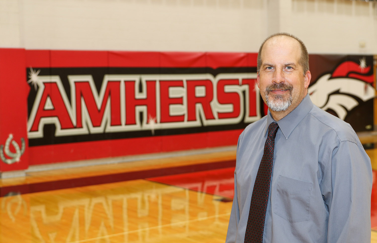 """Amherst Public School 7-12 Principal Roger Thomsen frequently turns to UNK students when he needs substitute teachers. """"The students who have full days available, we're bringing them in as much as possible,"""" Thomsen said."""