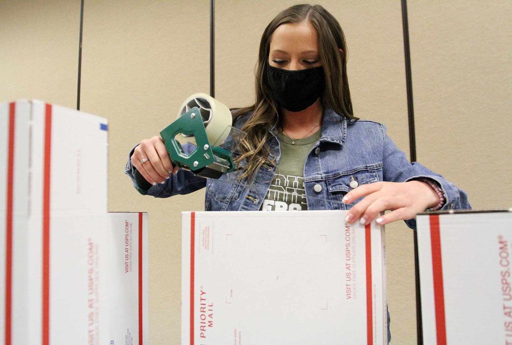 Rylee Schneider of Lincoln, a member of UNK's Alpha Omicron Pi sorority, prepares care packages for shipping Tuesday evening during the Sisters for Soldiers event. Alpha Omicron Pi is sending 451 holiday packages to U.S. military members serving overseas.