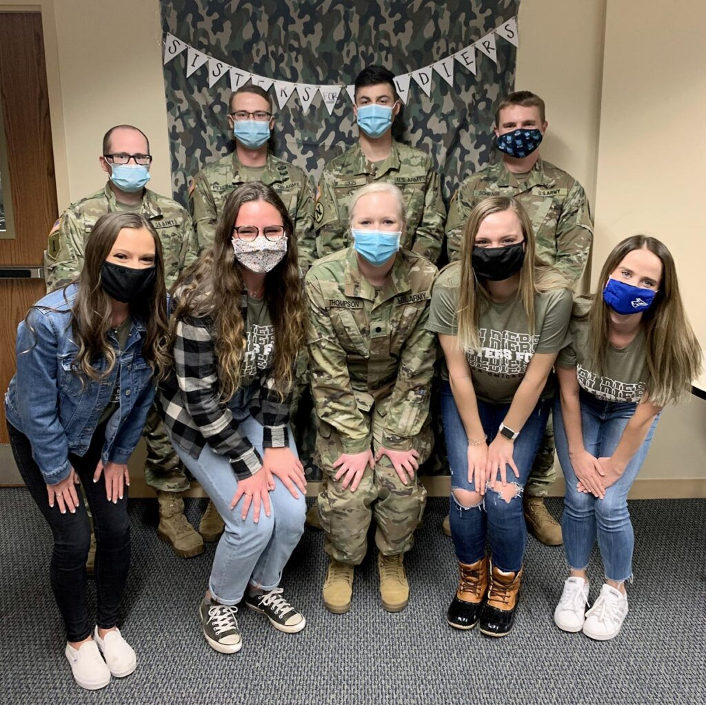Alpha Omicron Pi members pose for a photo with members of UNK's Army ROTC program during the Sisters for Soldiers event.