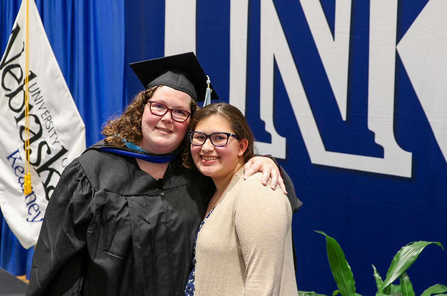 Alecia Amezcua of Madison, left, poses for a photo with her daughter Ariana following Thursday's commencement ceremony at the University of Nebraska at Kearney. Amezcua graduated from UNK with a master's degree in Spanish education. (Photos by Todd Gottula, UNK Communications)