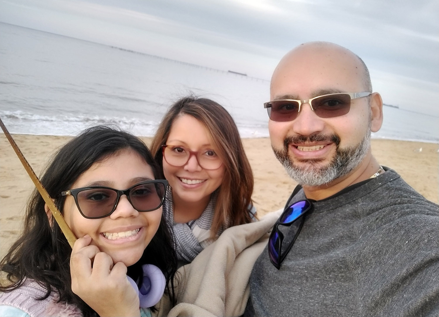 Leidimar Ramirez, center, lives in Newport News, Virginia, with her husband Ruben and their 11-year-old daughter Carmen. Ruben and Carmen will be in attendance tonight when Leidimar receives a master's degree in Spanish education from UNK. (Courtesy photos)