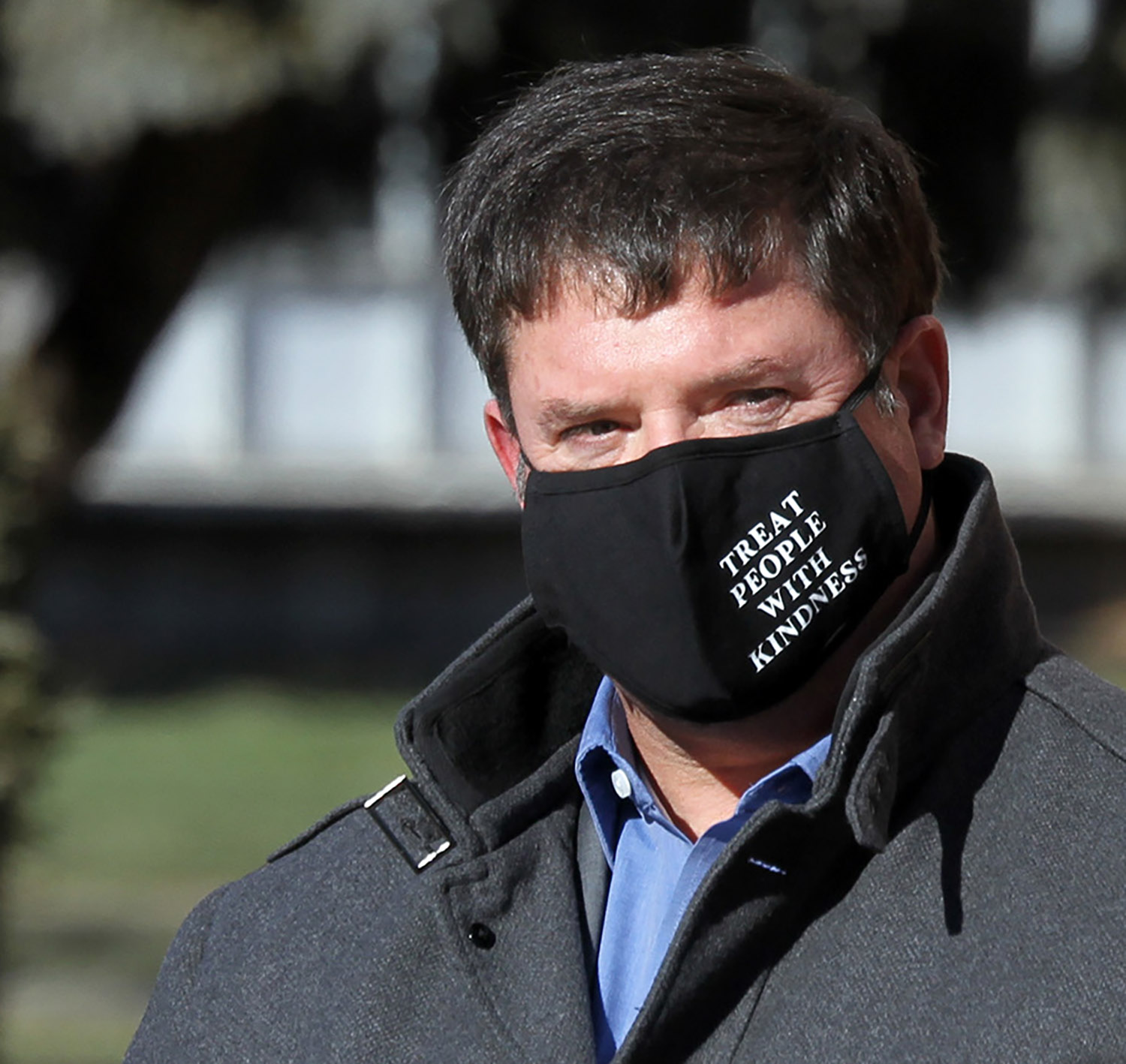 John Falconer's face mask says everything during a Martin Luther King Jr. Day event on the UNK campus. Falconer, senior adviser to the chancellor for executive affairs at UNK, organized Monday's ceremony to honor King's life and legacy and spread his message of peace and equality.