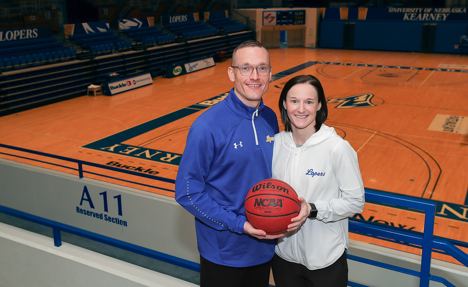 "As husband and wife, UNK women's basketball coaches Devin and Carrie Eighmey are teammates both on and off the court. ""It's a fairly easy transition for us when we go from home to the basketball court because we're both passionate about what we're doing and we're both very focused on our team and what we need to do to get better,"" Carrie says."