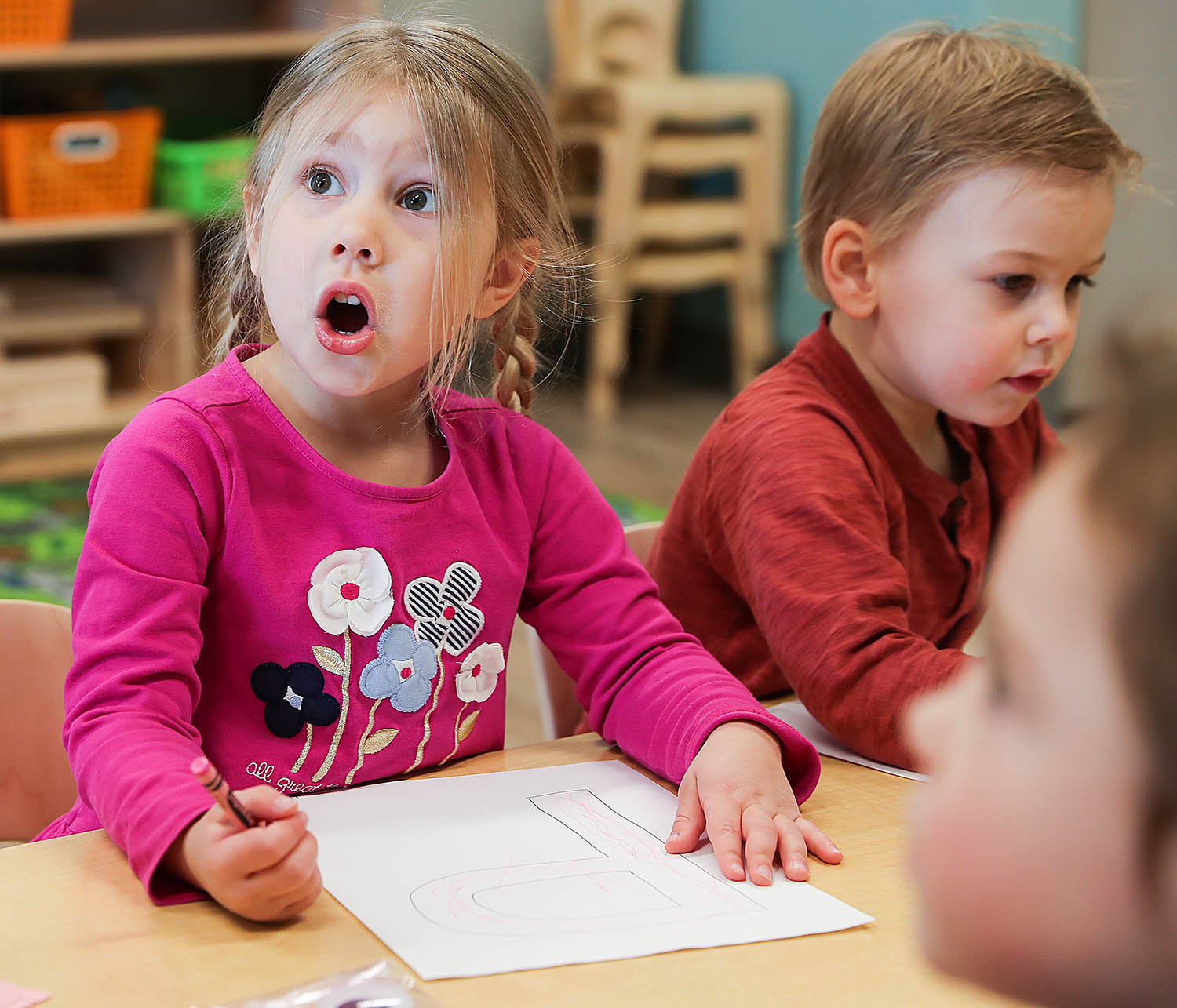 """Joselyn Bauer, 3, expresses excitement while learning about the letter """"P"""" as her classmate Sebastian Jensen, 3, colors his letter in the preschool transition class at UNK's LaVonne Kopecky Plambeck Early Childhood Education Center."""