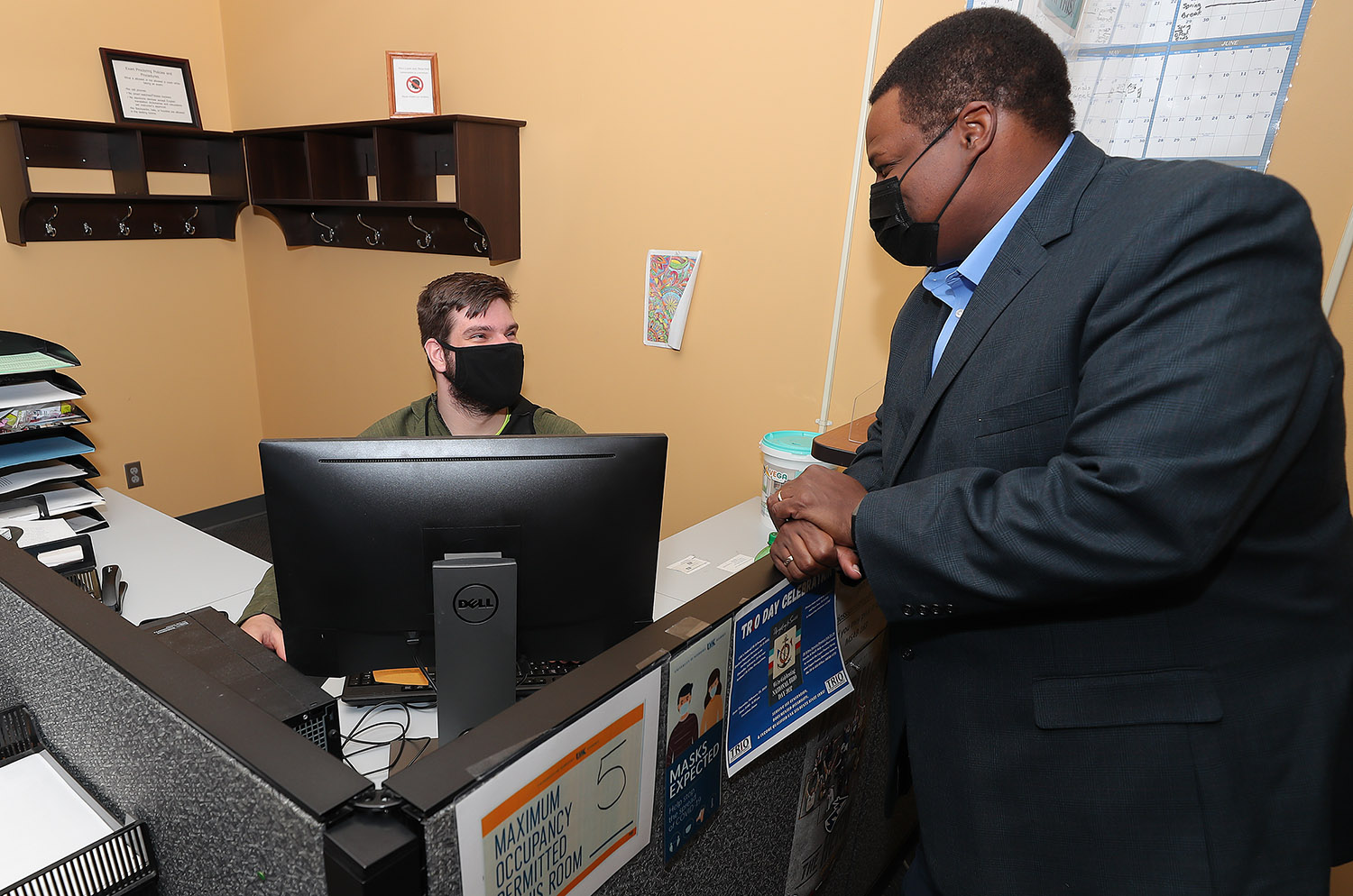 UNK student Christian Mikulecky of Omaha, left, and TRIO Student Support Services Assistant Director Rashawn Harvey chat inside the Academic Success Offices on campus. TRIO assists first-generation and income-qualified students and those with documented disabilities during their pursuit of a college degree by providing academic and personal support, financial guidance and career development opportunities. (Photos by Erika Pritchard, UNK Communications)