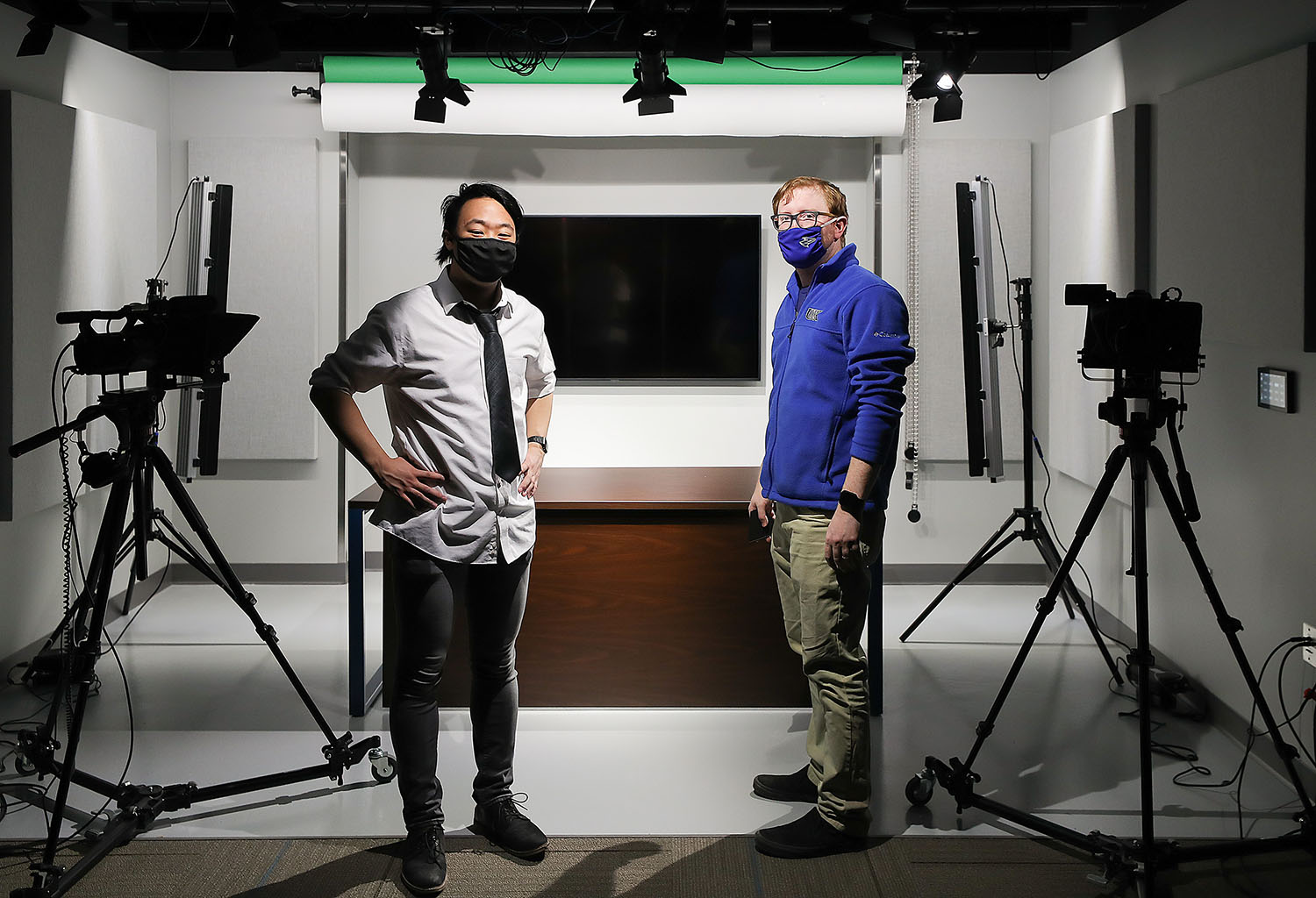 """UNK junior Ryan Range, left, and associate communication professor Jacob Rosdail are pictured in the video studio inside Mitchell Center on campus. Range produced his documentary, """"When The World Closed,"""" while working with Rosdail through UNK's Summer Student Research Program."""