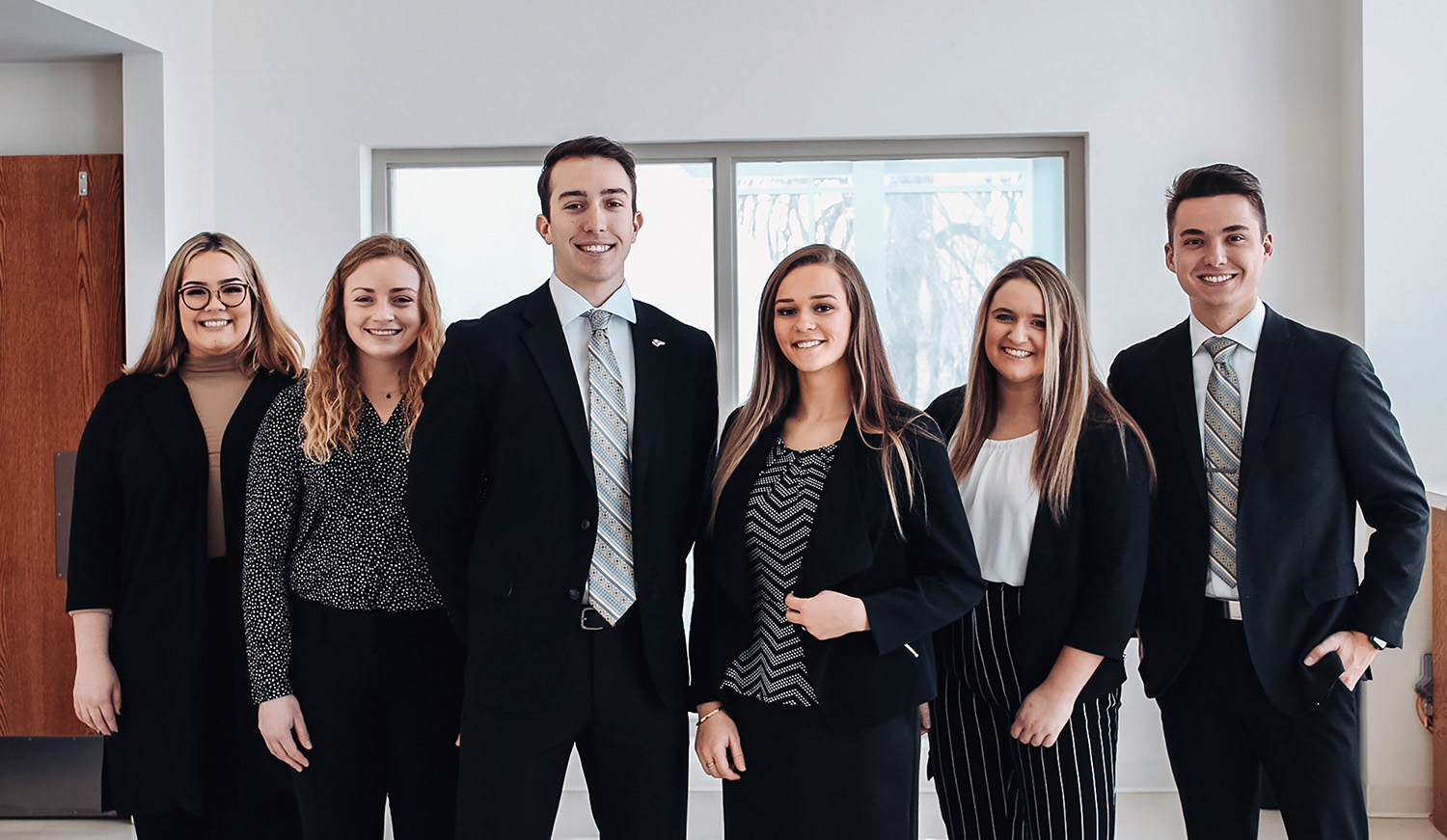 Noah Limbach, third from left, and Tristan Larson, fourth from left, will serve as UNK student body president and vice president for 2021-22. Their executive cabinet members are, from left, Chief of Staff Maria Garcia Quintana, Secretary of Student Affairs Grace Tolstedt, Secretary of Community Relations Tatum Vondra and Secretary of the Treasury Ryan Woitalewicz. (Photos courtesy of Cassidy Stelling)