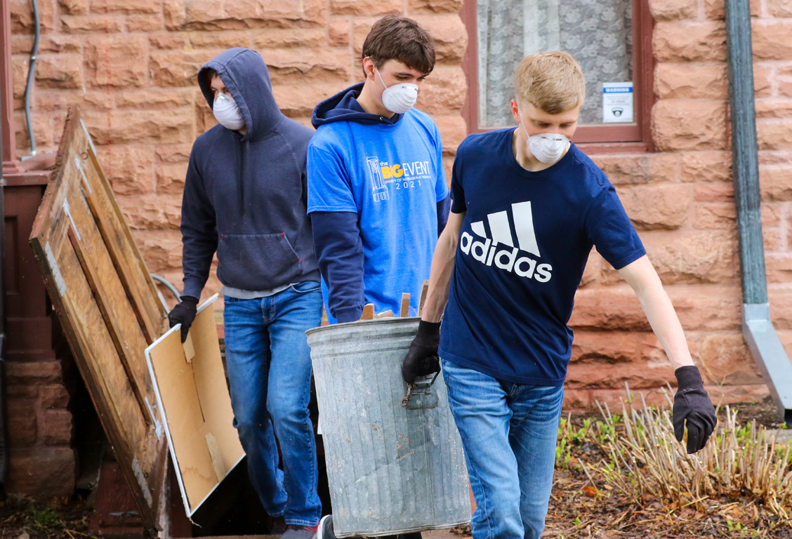 UNK students remove items from the basement of the G.W. Frank Museum of History and Culture during The Big Event.
