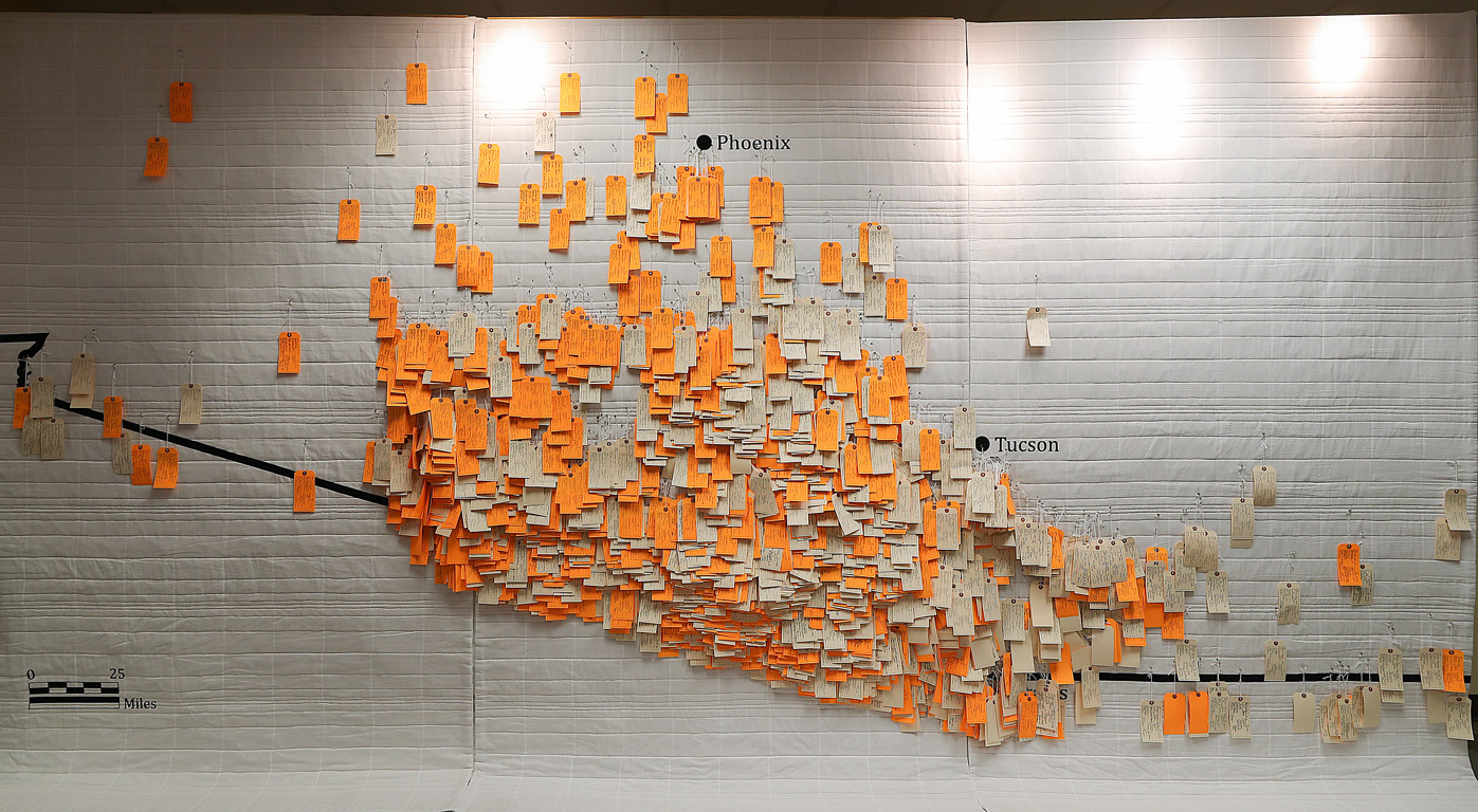 """The """"Hostile Terrain 94"""" exhibit is composed of roughly 3,200 handwritten toe tags attached to a map of the Arizona-Mexico border in the exact locations where the bodies of undocumented immigrants were found. (Photos by Erika Pritchard, UNK Communications)"""