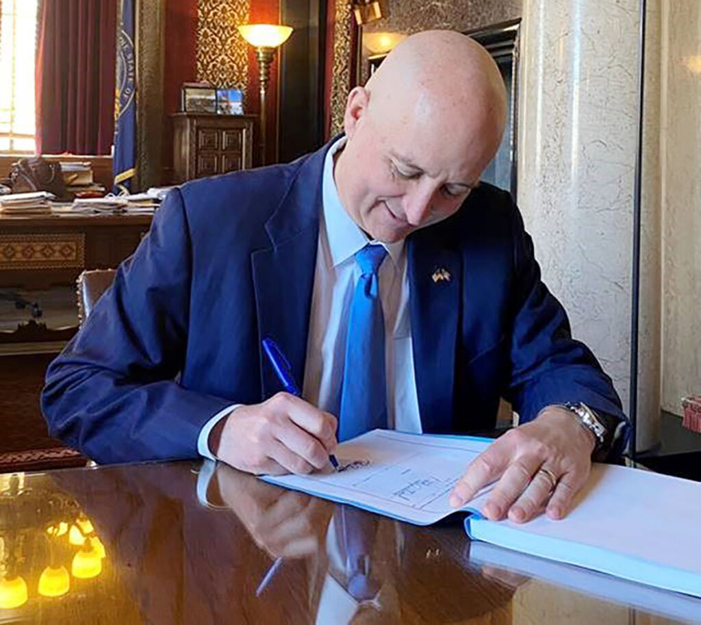 Gov. Pete Ricketts signs the state budget into law Monday.