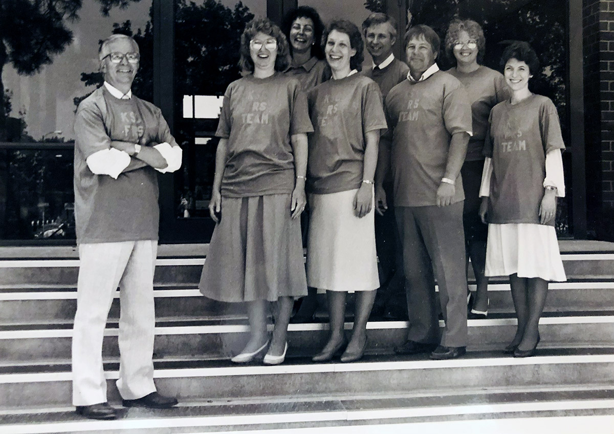 Jean Mattson, front right, was part of the team that implemented the first computerized financial records system at Kearney State College in the late 1980s. She's pictured with team members, front row from left, Earl Rademacher, Deb Schroeder, Teena Ehly Swenson and Larry Riessland and, back row from left, Jane Sheldon, John Lakey and Kathy Livingston.