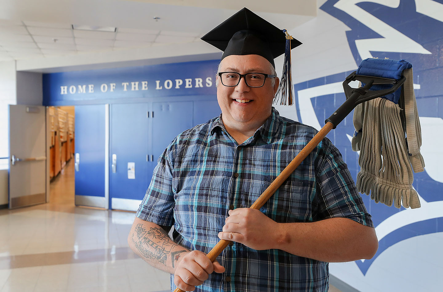 Sonny O'Connor worked as a custodian while attending UNK and used the university's employee scholarship program to cover tuition costs. He'll graduate Friday with a bachelor's degree in general studies. (Photo by Erika Pritchard, UNK Communications)