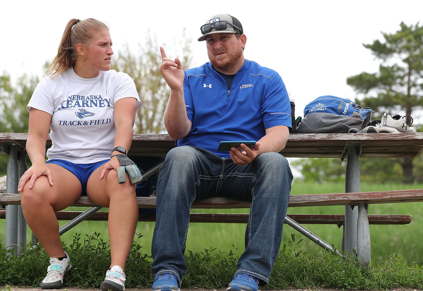 Tiara Schmidt is pictured with throws coach Dane Tobey during a recent practice on the UNK campus.