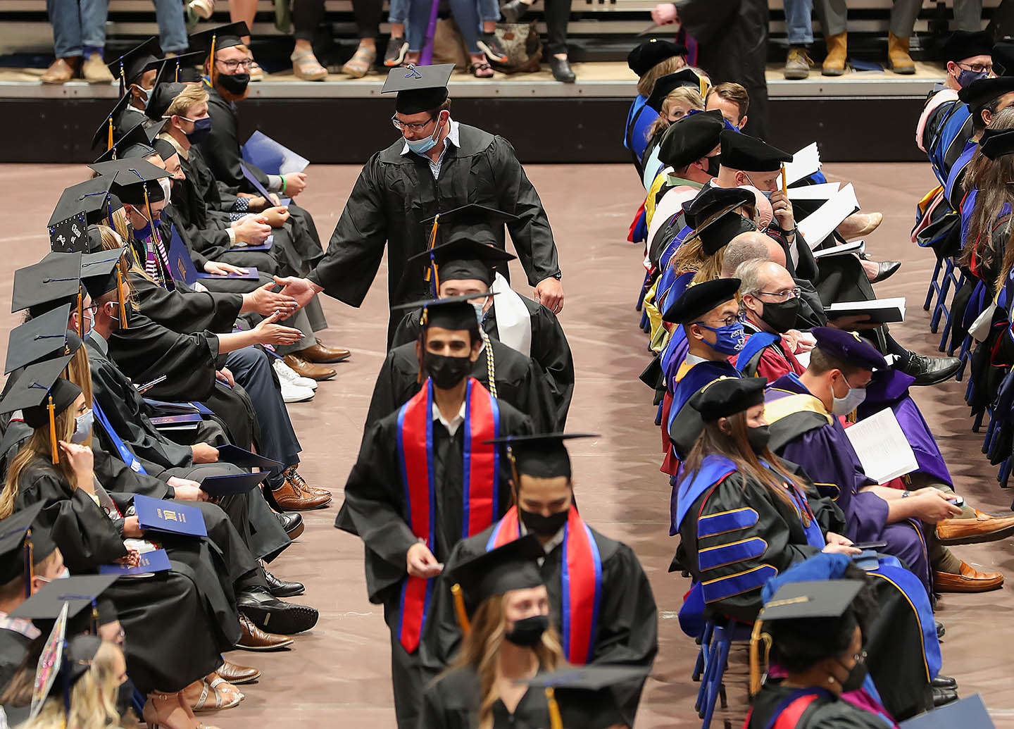 UNK conferred undergraduate degrees for about 500 students on Friday, and a separate graduate-degree hooding ceremony is scheduled for 10 a.m. Saturday at the Health and Sports Center. Nearly 200 degrees will be awarded during that event.