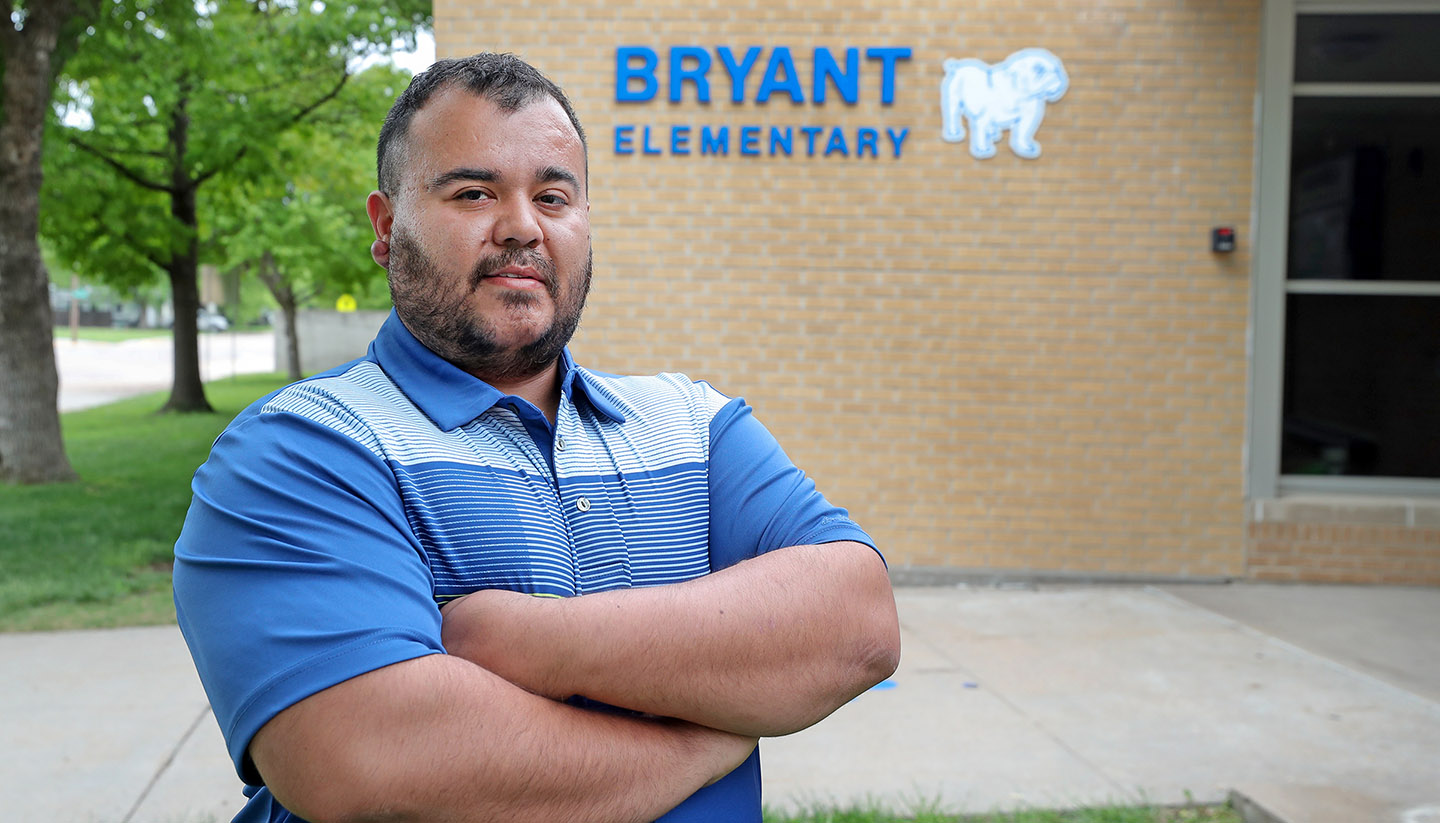 Carlos Ortega didn't know English when his family immigrated to the United States two decades ago. Now he works as a paraprofessional in the ESL program at Bryant Elementary School in Kearney while attending UNK. (Photo by Erika Pritchard, UNK Communications)