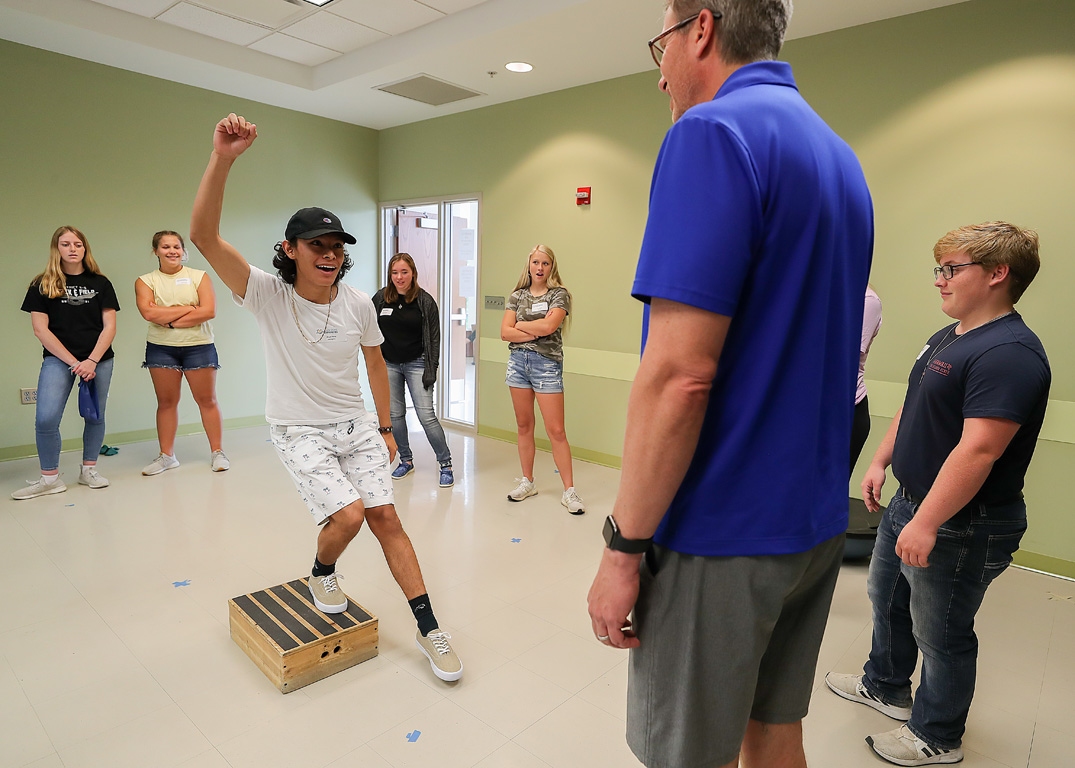 Angel Perez, a senior from Lexington, practices a physical therapy exercise Friday during the Health Science Explorers summer camp.