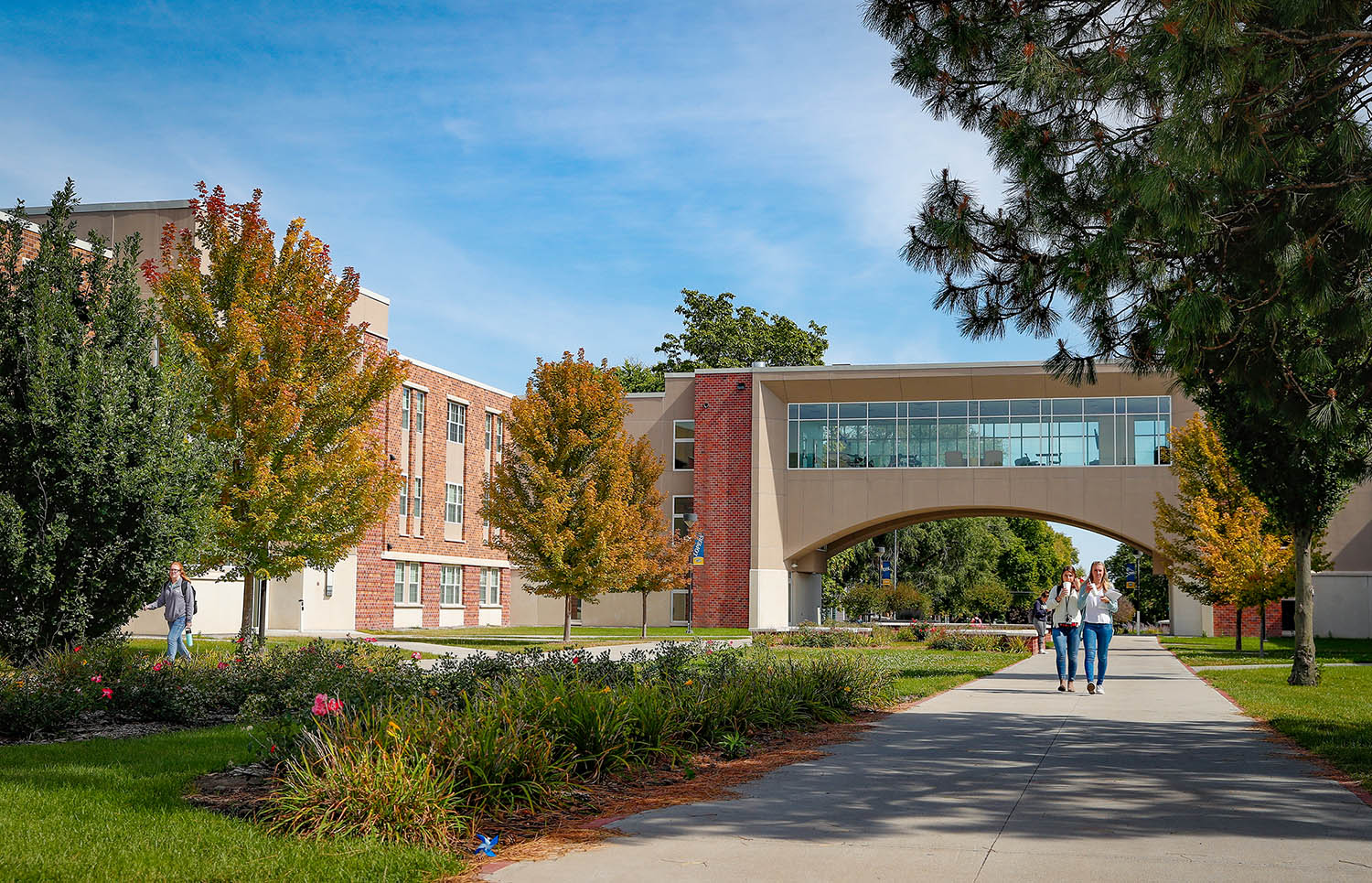 William Nester, the first chancellor of UNK, led the school's transition into the University of Nebraska system in 1991. Nester Hall is named in his honor, with the University View elevated walkway and lounge representing his vision for the campus.