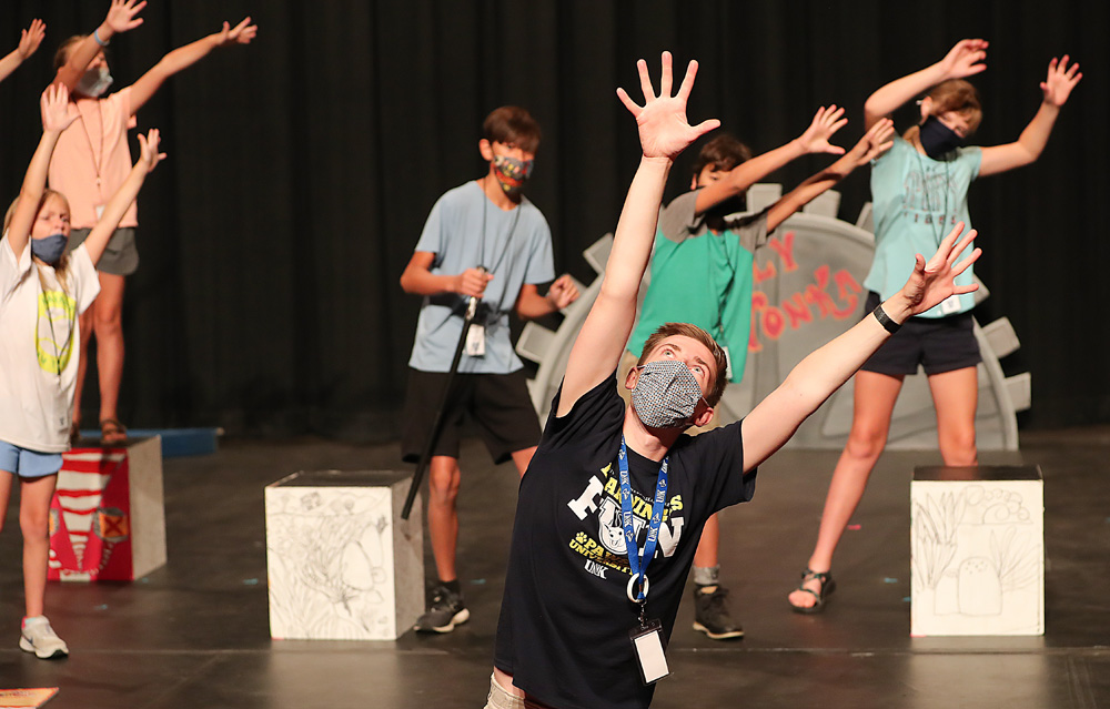 """Crane River Theater Education Director Matthew Briggs teaches children choreography for the ending number of """"Willy Wonka Kids!"""" last week at UNK's Miriam Drake Theatre."""