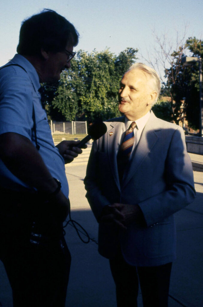 William Nester, right, speaks to a reporter during a campus celebration on July 1, 1991, when Kearney State College officially joined the University of Nebraska system. Nester led the transition as president of Kearney State College before becoming the first chancellor of UNK.