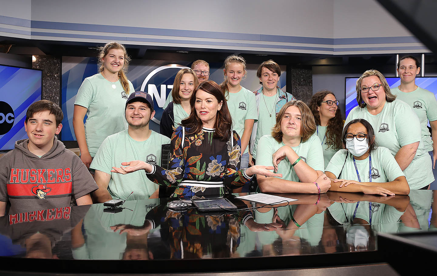 NTV news anchor Colleen Williams introduces members of UNK's Digital Expressions Media Camp during Tuesday evening's newscast. (Photos by Erika Pritchard, UNK Communications)