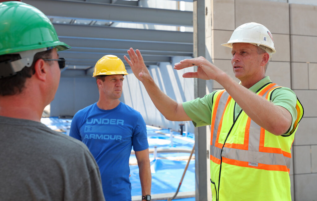 Kearney Park and Recreation Director Scott Hayden, right, discusses the new indoor tennis complex with UNK tennis coach Scott Shafer, center, and Kearney High School tennis coach Troy Saulsbury during a tour of the facility Monday afternoon.