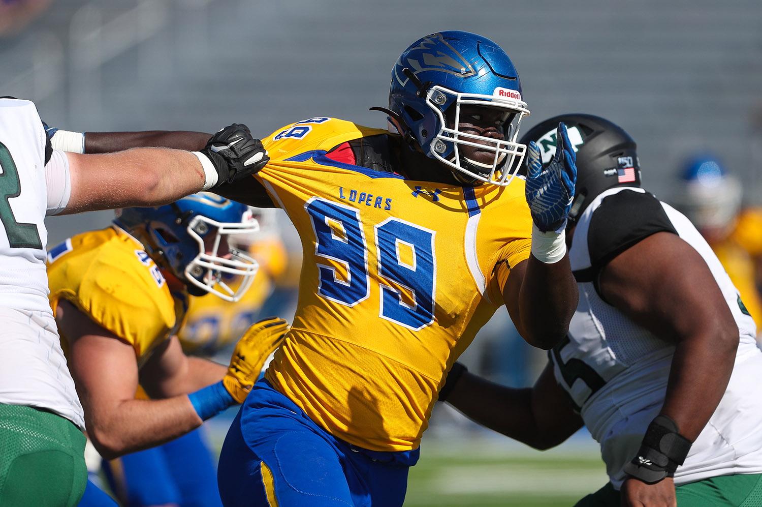 Hinwa Allieu (99) played football for UNK from 2016-19, recording 160 tackles and 15.5 sacks for the Lopers. The three-time All-MIAA selection signed with the Atlanta Falcons as an undrafted free agent in April 2020.